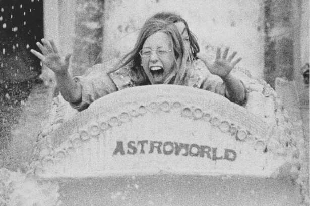 A rider gets splashed on AstroWorld's Bamoo Shoot Ride on June 1, 1973.