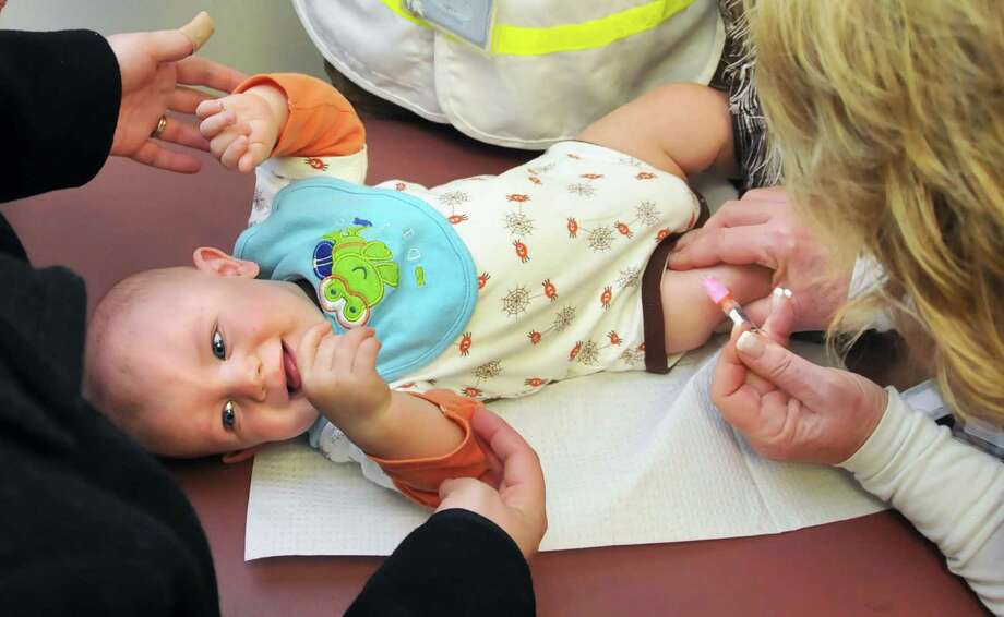 7-month-old Nathan Fischer of Niskayuna gets an H1N1 flu shot during a Schenectady County health department clinic for children under 5 years old at the Annie Schaffer Senior Center Tuesday afternoon November 10, 2009.  (John Carl D'Annibale / Times Union) Photo: John Carl D'Annibale / 00006340A