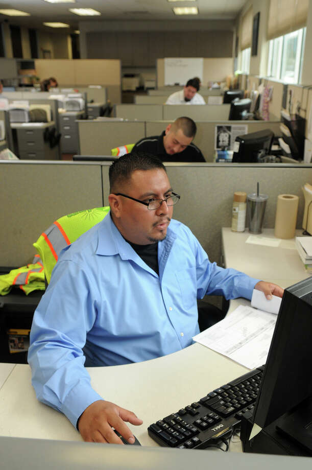 DGM Services, Inc. (DGM) DG Specialist Sam Peredo puts his game face on at one of Houston's top work places. Photo: Jerry Baker, Freelance