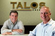 Ben Winkelman, senior geoscientist, left, and Michael Harding, chief accounting officer and controller, pose for a photo at Talos Energy Thursday, Sept. 26, 2013, in Houston. ( Brett Coomer / Houston Chronicle )
