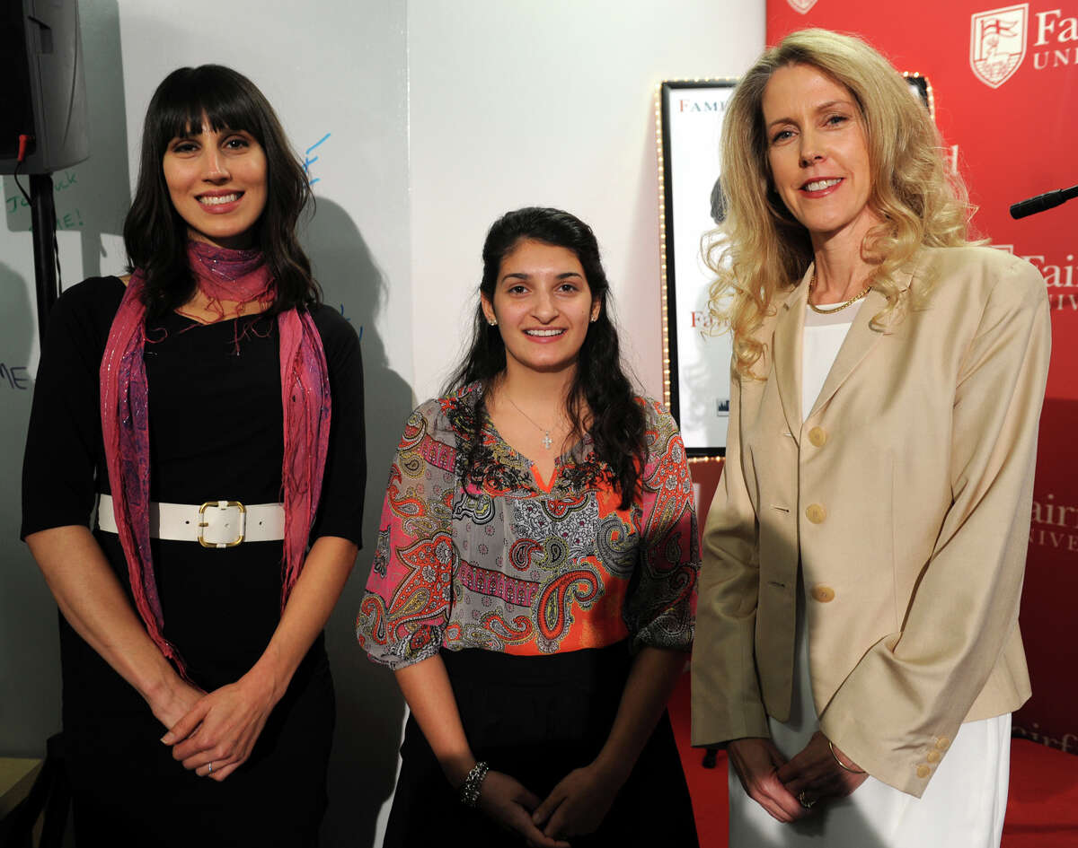 From left, Nicole Juliano Peranick, Jamie Ramerini and Daphne Dixon pose during the opening ceremony of the new Fairfield University Accelerator and Mentoring Enterprise (FAME), in Fairfield, Conn., Oct. 29, 2013. The three women and their businesses have been selected to be part of the business incubator program.