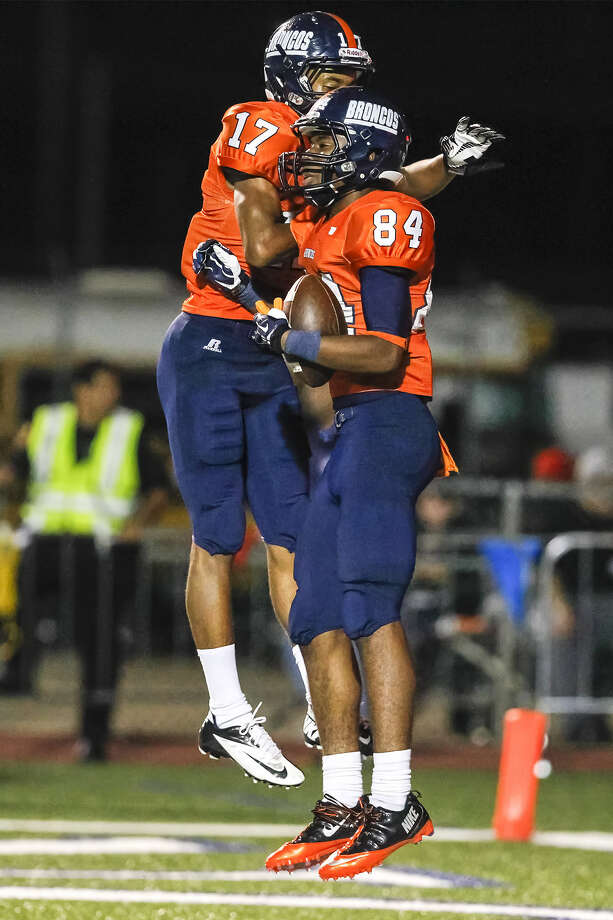 Brandeis's Larry Stephens, right, celebrates a touchdown reception with wide receiver Peyton Hall during a Sept. 29 game. They have reason to celebrate: Their team is in a great spot to move into the playoffs.