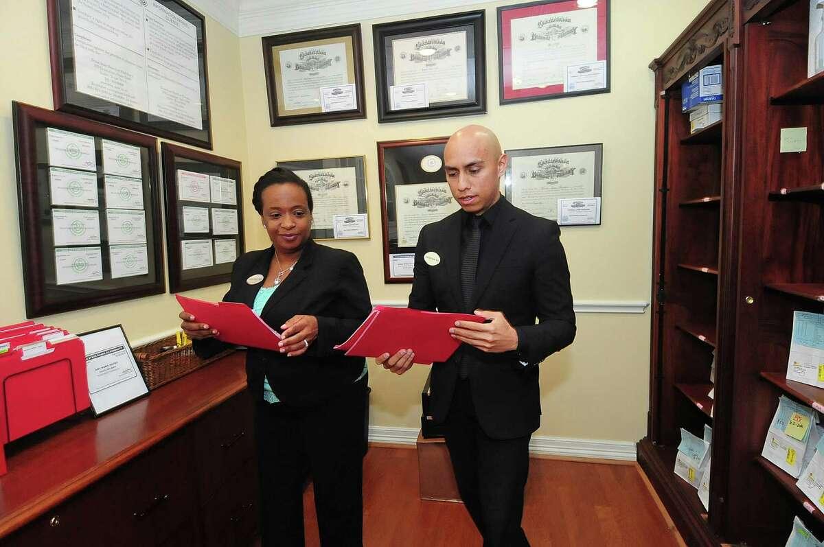 Dawn Peace and Jonathan Deanda work in the pharmacy at Hotze Health & Wellness Center.