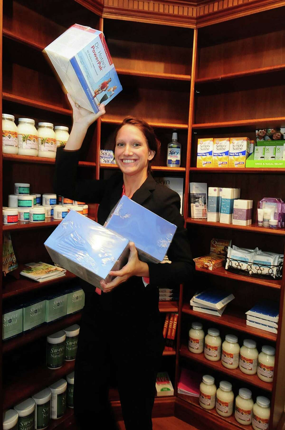 Amy McCance (Digital Marketing Specialist) with some of the product available at Hotze Enterprises in Katy Thursday 9/26/13.