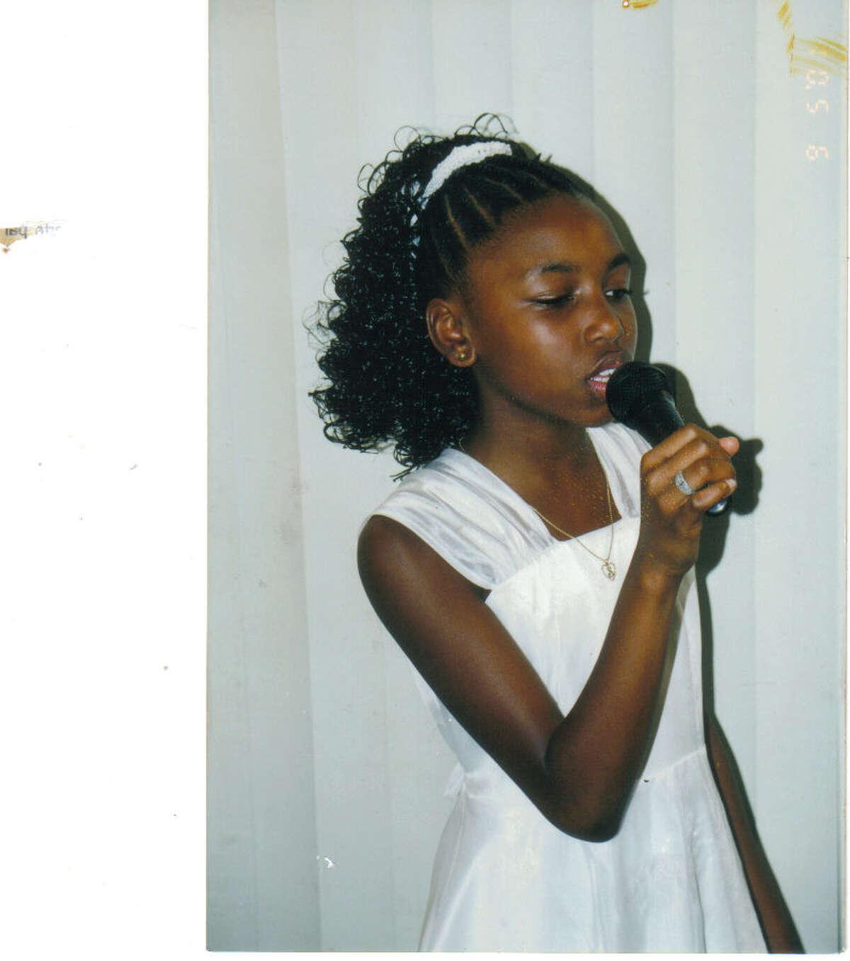 Tamara Chauniece was 10 when she sang at this wedding.