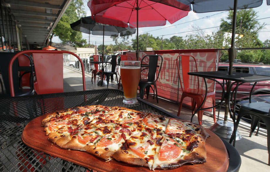 A pizza on the patio at City Oven. Photo: James Nielsen, Houston Chronicle / © 2013  Houston Chronicle