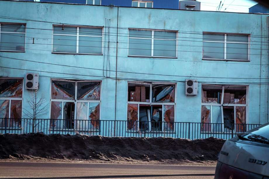 A view of the facade of a local paint and varnish plant which was damaged by a shockwave from a meteor in the Urals city of Chelyabinsk, on February 15, 2013. A meteor strike in central Russia that left today hundreds of people injured is the biggest known human toll from a space rock, a British expert said. AFP PHOTO / 74.RU/ OLEG KARGOPOLOV
