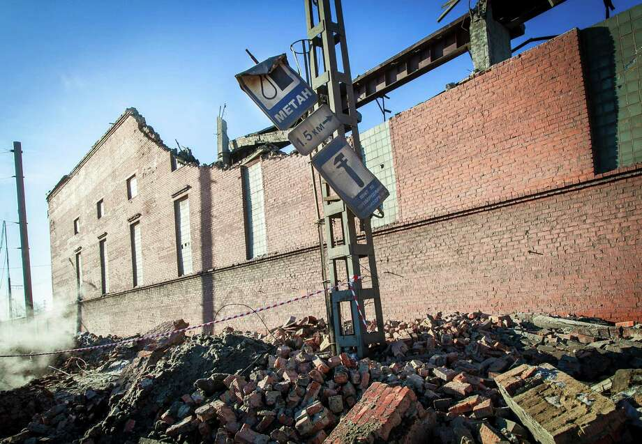 A view of  the wall of a local zinc plant which was damaged by a shockwave from a meteor in the Urals city of Chelyabinsk, on February 15, 2013. A meteor strike in central Russia that left today hundreds of people injured is the biggest known human toll from a space rock, a British expert said. AFP PHOTO / 74.RU/ OLEG KARGOPOLOV --BEST QUALITY FROM SOURCE-- Photo: AFP, Getty Images / 2013 AFP
