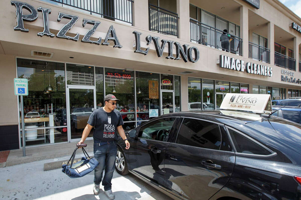 Pizza deliveryman Stephen Galindo gets into his car at Pizza L'Vino. L'Vino is located at 544 Waugh Dr.