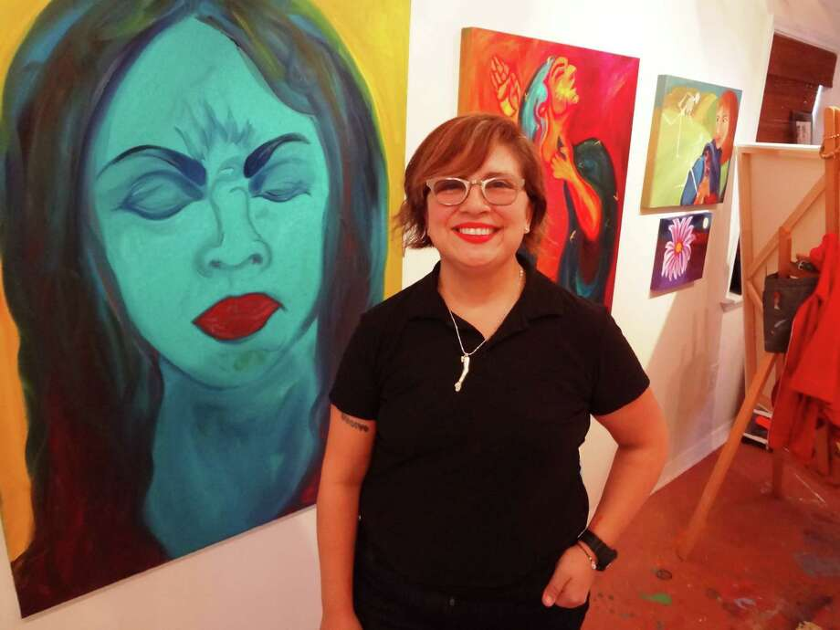 "Anel Flores, with a painting called ""Pensando: Thinking"" in her Olmos Park Terrace studio, strives to give voice to women in her artwork. Photo: Steve Bennett / San Antonio Express-News"