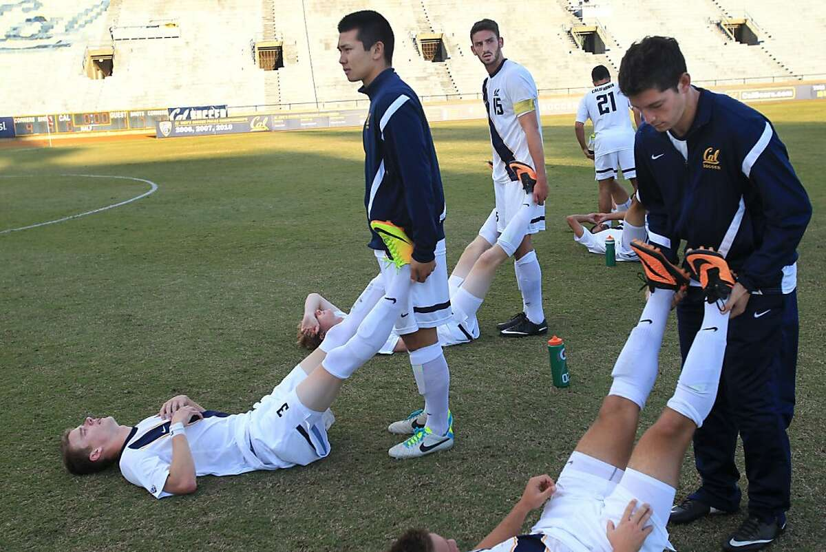 Cal's Steve Birnbaum, fourth from left, stretches his teammate Mason Case after their team lost a match against University of San Diego October 25, 2013 at Goldman Field at Edwards Stadium in Berkeley,