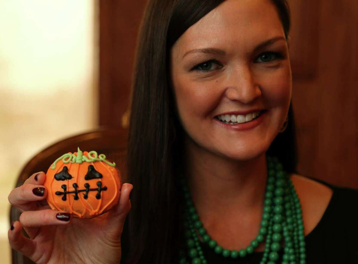 Lisa Pounds, CEO and founder of Green Plate Foods holds one of their decorated Zucchini Chocolate Chip Cookies, one of several types of Halloween treats for parents who want to serve healthy treats to their own kids and trick or treaters, Tuesday, Oct. 22, 2013, in Houston. ( Karen Warren / Houston Chronicle )