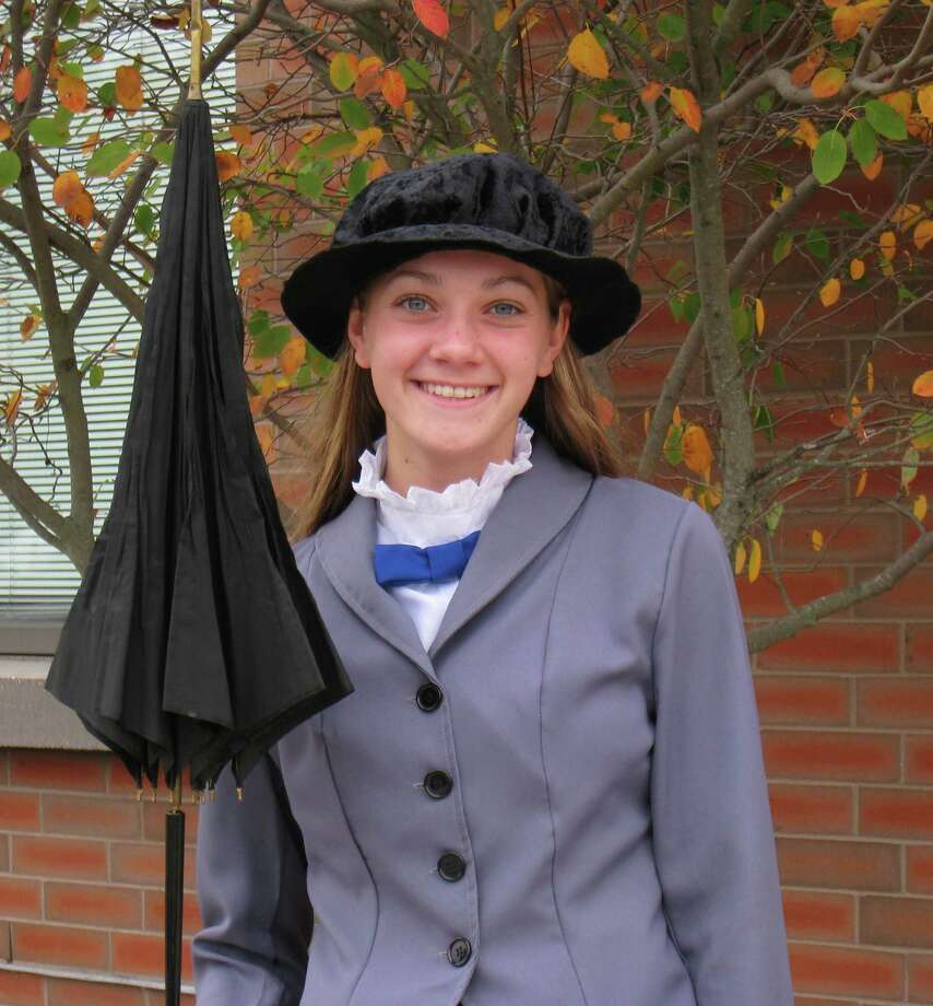 Darien High School violist Becca Maroney is dressed as Mary Poppins for the special sing-a-long at the high school Tuesday, Nov. 5. Photo: Contributed Photo, Contributed / Darien News