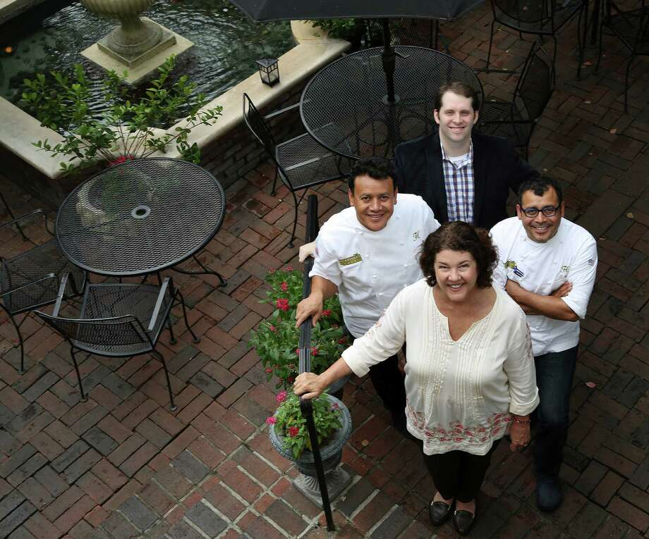 """Backstreet Cafe owners Tracy Vaught and Hugo Ortega at the restaurant, with Ruben Ortega and Sean Beck, Tuesday, Oct. 15, 2013, in Houston. Backstreet Cafe is marking its 30th anniversary this month with the publication of its first cookbook, """"Backstreet Kitchen"""".  ( Karen Warren / Houston Chronicle ) Photo: Karen Warren, Staff / © 2013 Houston Chronicle"""