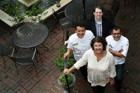 """Backstreet Cafe owners Tracy Vaught and Hugo Ortega at the restaurant, with Ruben Ortega and Sean Beck, Tuesday, Oct. 15, 2013, in Houston. Backstreet Cafe is marking its 30th anniversary this month with the publication of its first cookbook, """"Backstreet Kitchen"""".  ( Karen Warren / Houston Chronicle )"""