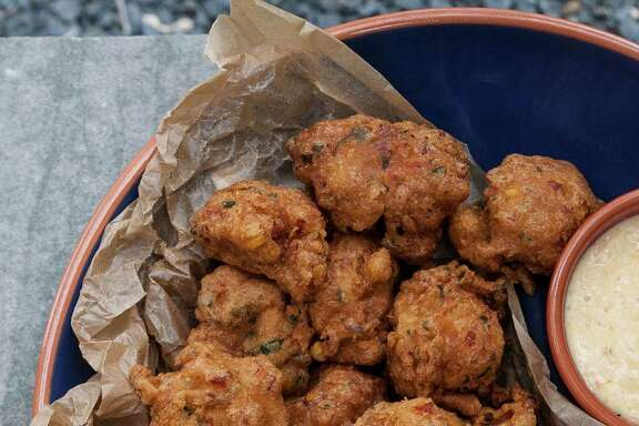 "Crawfish Beignets from ""Backstreet Kitchen: Seasonal Recipes from Our Neighborhood Cafe"" by Tracy Vaught and Hugo Ortega."