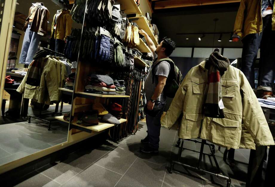 In this Friday, Oct. 4, 2013, photo, a shopper browses at a Timberland store in Skokie, Ill. The Conference Board releases the Consumer Confidence Index for October on Tuesday, Oct. 29, 2013. (AP Photo/Nam Y. Huh) ORG XMIT: NYBZ130 Photo: Nam Y. Huh / AP