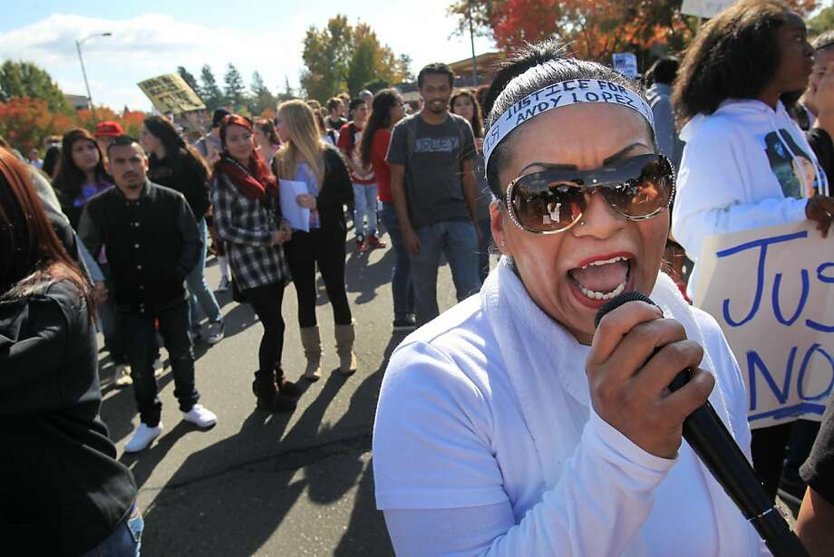 Gracela Rebira leads chants as the marchers carry signs along Mendocino Avenue to the headquarters of the Sonoma County Sheriff's Office in Santa Rosa. Photo: Leah Millis, The Chronicle