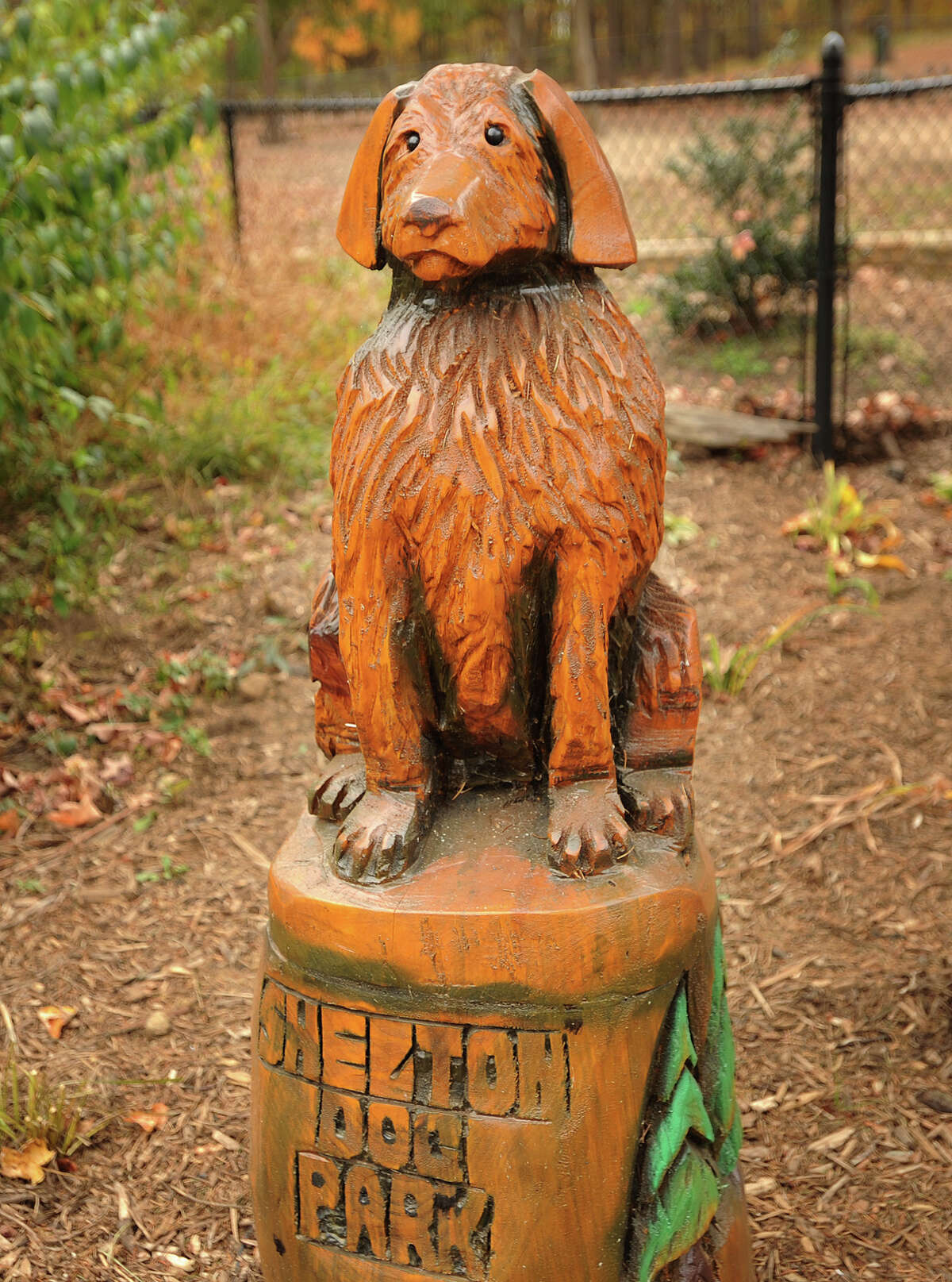 Dog sculptures carved from logs decorate the outside of the Shelton Dog Park on Nells Rock Road in Shelton, Conn. on Tuesday, October 29, 2013.