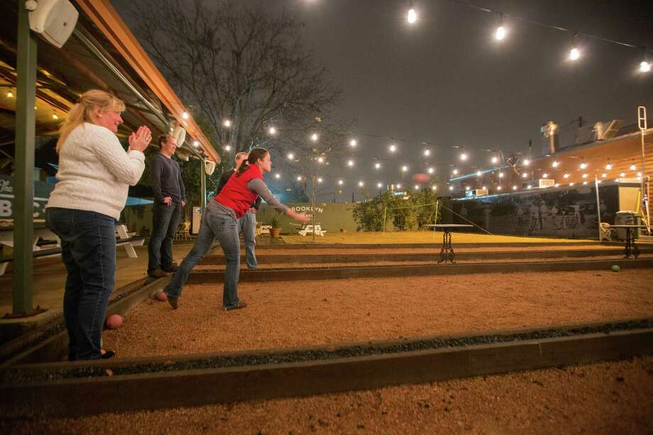 A group of friends plays bocce ball, Friday, January 11, 2013 at Brooklyn Athletic Club in Houston, Texas. The newly opened bar features a host of outdoor activities such as croquet, bocce ball, badminton and ping pong. (Todd Spoth/For the Chronicle) Photo: TODD SPOTH, Photographer / Todd Spoth