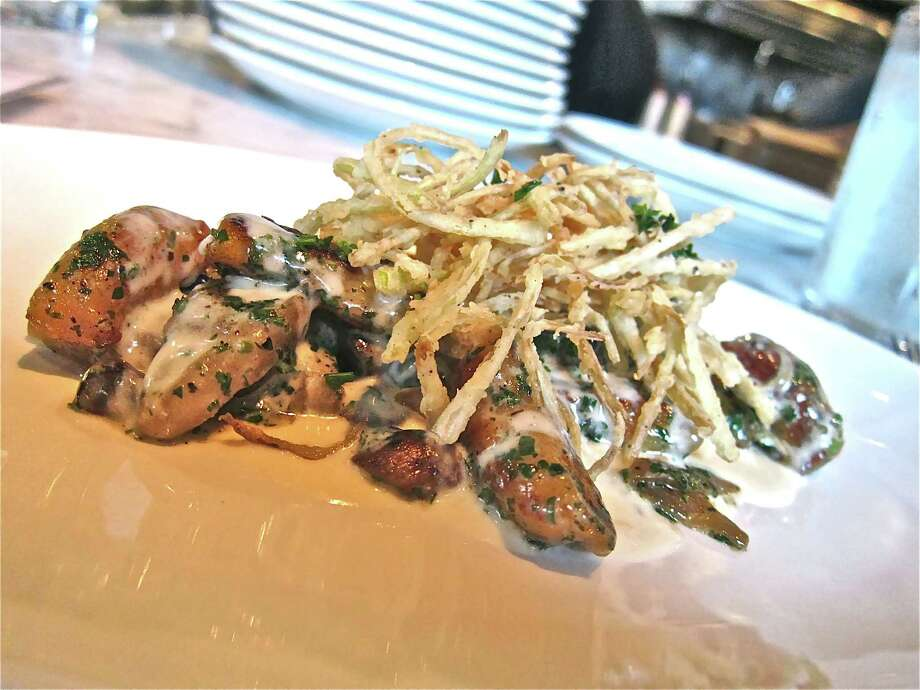 Sweet potato gnocchi with caramelized mushrooms, crispy leeks, apple and sage at the Brooklyn Athletic Club. Photo: Alison Cook