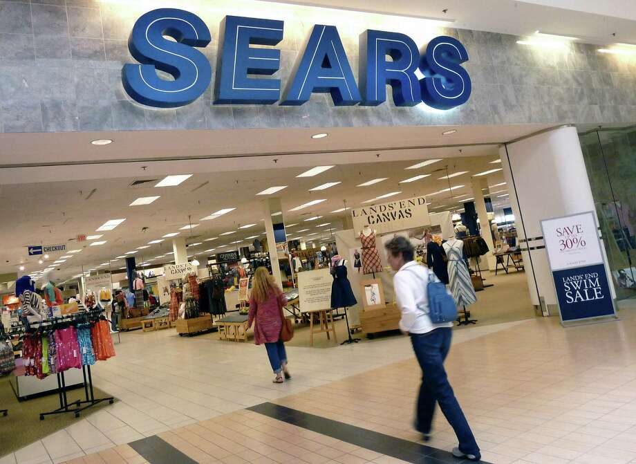 FILE - In this Monday, May 14, 2012, file photo, shoppers walk into Sears in Peabody, Mass. Sears is considering separating its Lands' End and Sears Auto Center businesses from the rest of the company. The retailer also plans to continue closing some of its unprofitable stores as it moves forward on its turnaround efforts, the company announced Tuesday, Oct. 29, 2013. (AP Photo/Elise Amendola, File) ORG XMIT: NY110 Photo: Elise Amendola / AP