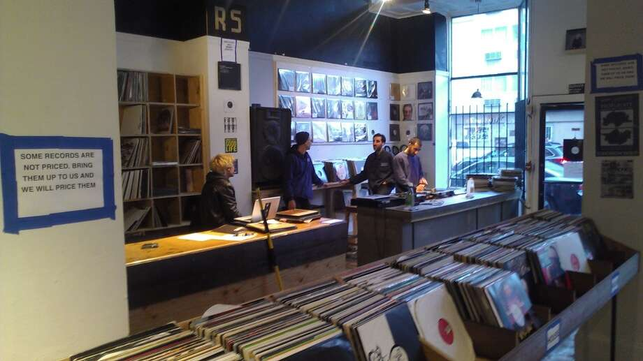 The crew at the counter of RS04109, a new record store on Larkin at Hyde. The Chronicle/Sam Whiting