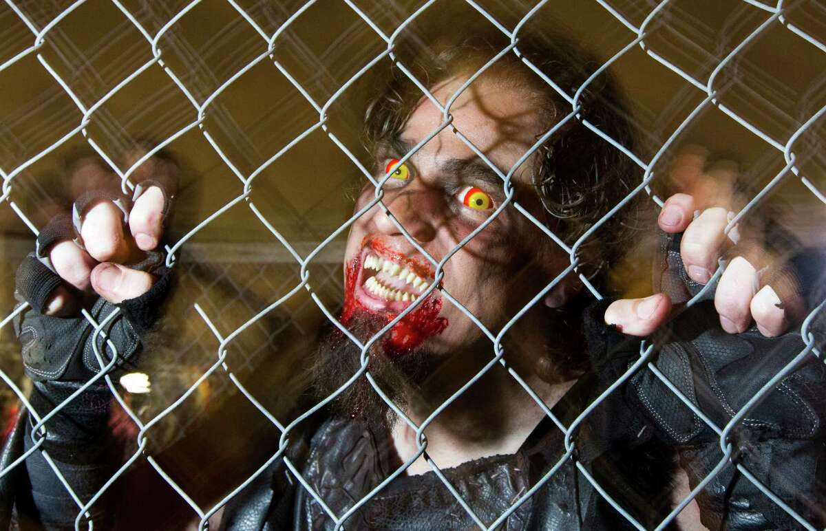 A zombie waits for guest to enter the maze at Scream World on Sunday, Oct. 27, 2013, in Houston. ( J. Patric Schneider / For the Chronicle )