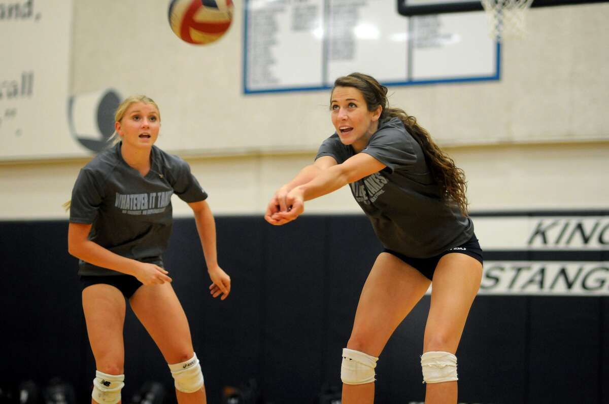 Kingwood's Michelle Matthews, from left, and Erin Hester are two big reasons why the Mustangs enter the playoffs as one of the favorites to advance to the state tournament.