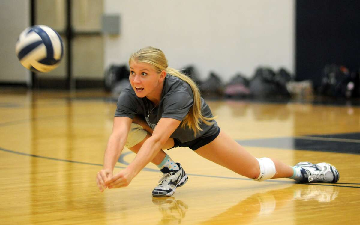 Kingwood's Michelle Matthews works on her passing technique during a team practice.