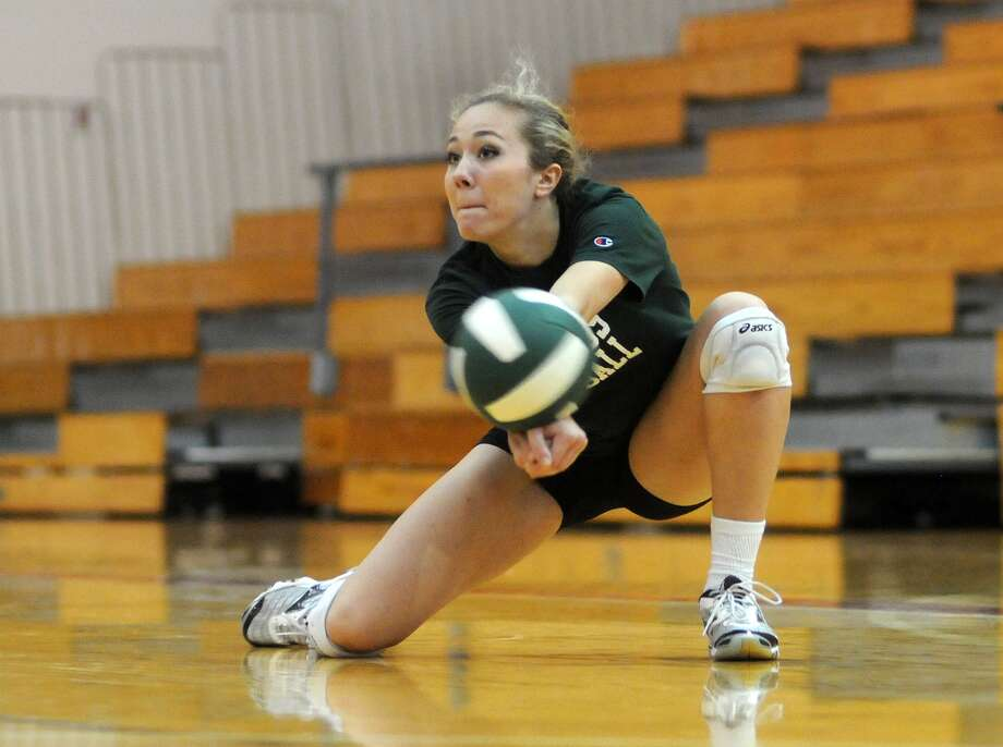 The Woodlands junior outside hitter Julie Pasch and the Highlanders are moving into the postseason as favorites to go all the way to state. Photo: Jerry Baker, Freelance