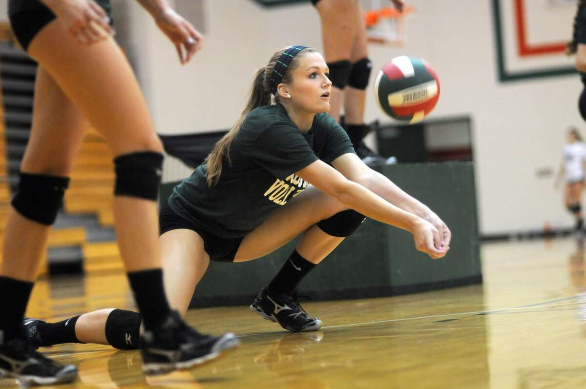 The Woodlands senior outside hitter Madison McDaniel works on her passing technique during a team practice.