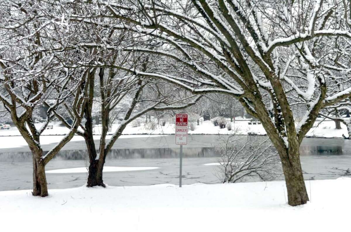 Snow in Bruce Park, with a sign saying Danger No Skating, on January 28, 2010.