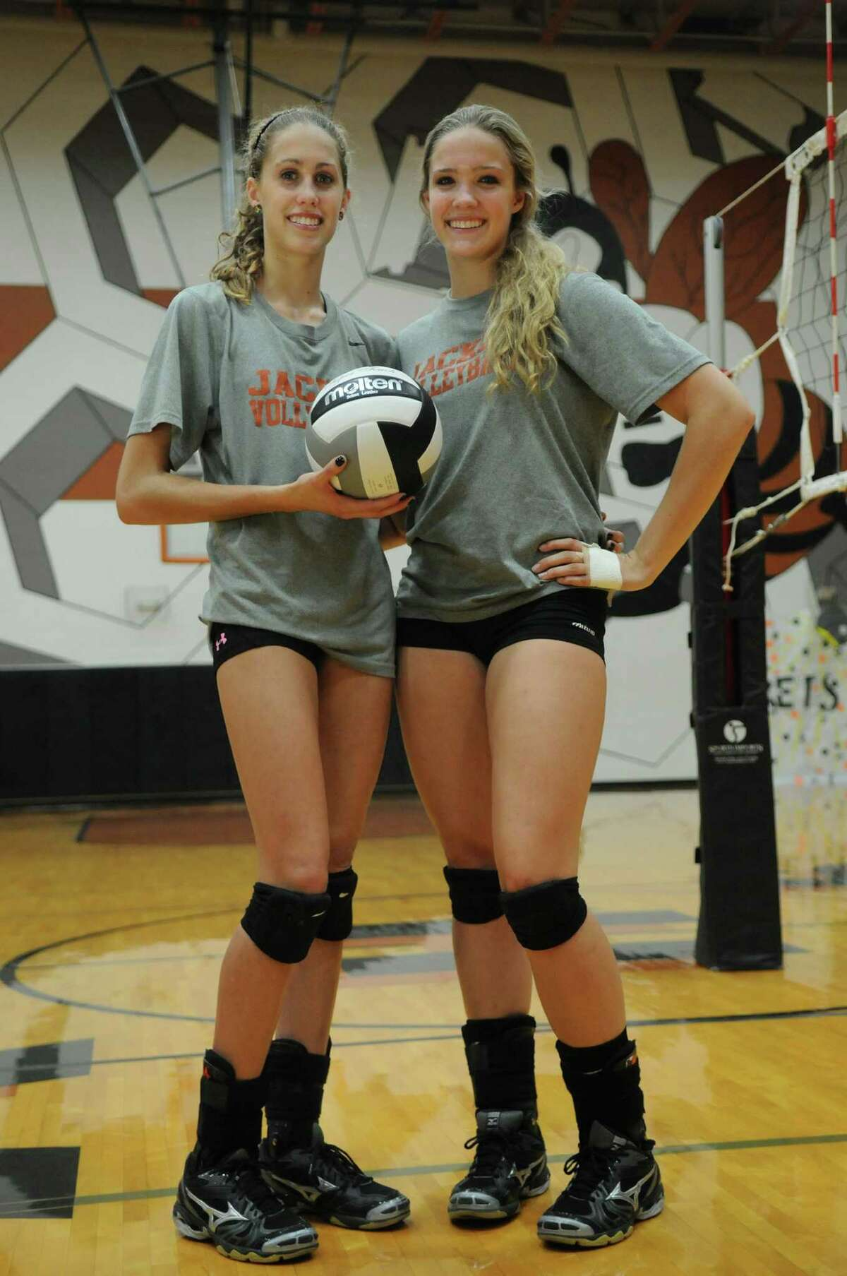 Alvin junior setter Elyssa Purcell, from left, and her twin sister, Kelsey, an outside hitter, make Lady Yellowjacket volleyball a family affair.