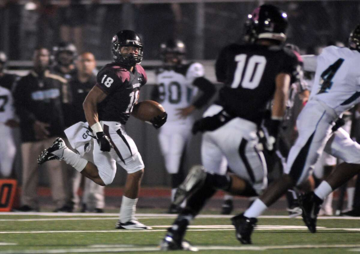 Pearland senior wide receiver Jacoby Lewis (#18) outruns the Pasadena Memorial defense to the end zone during their game at The Rig.