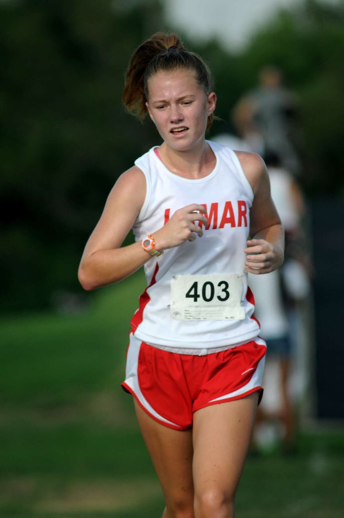 Houston Lamar's Jordan Reeves competes in the Girls Varsity Race at the Houston Christian Invitational Cross Country meet at Houston Christian High School.