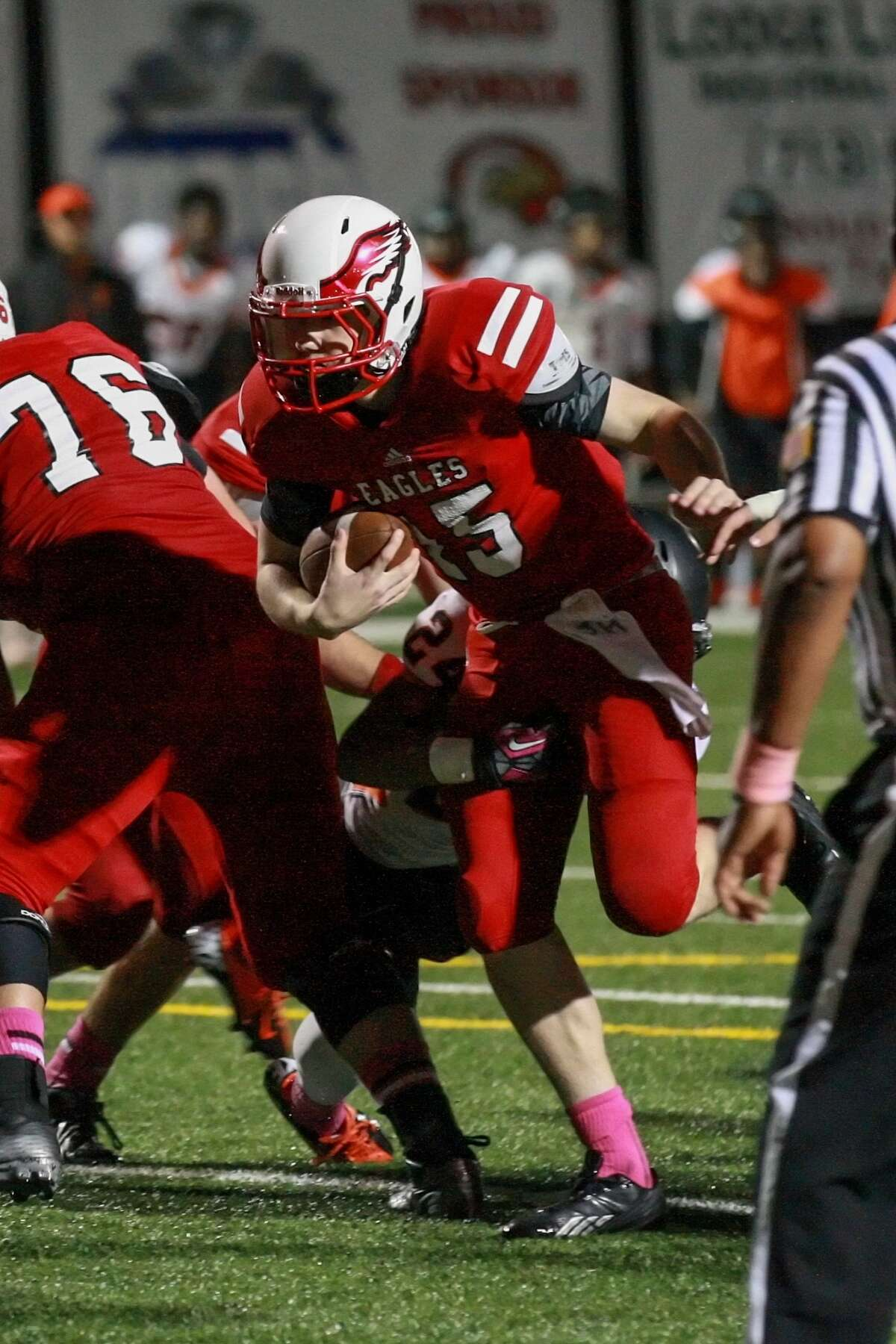 Michael Keating of St. Thomas runs the ball up the middle for a touchdown in the win over league rival St. Pius.