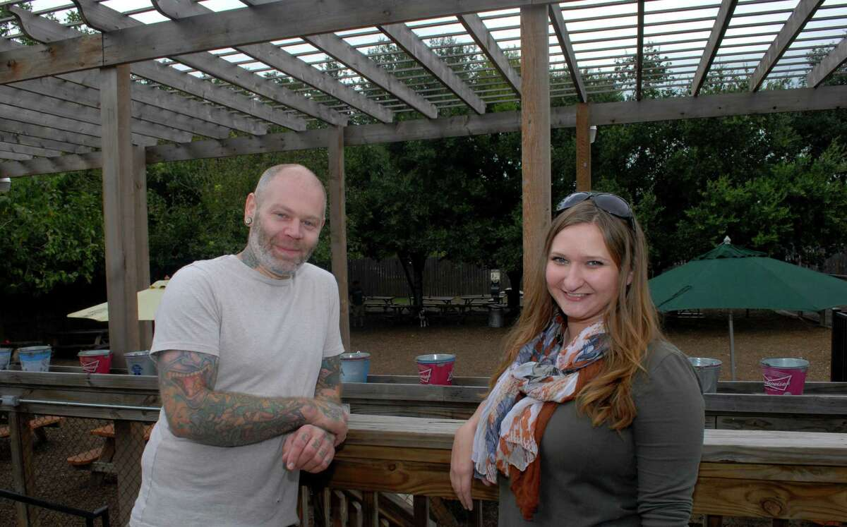 Kristy Gillentine, shown with Boneyard Drinkery manager Zac Hagen, is planning a Halloween event for dog owners and their pets at the canine-friendly bar.
