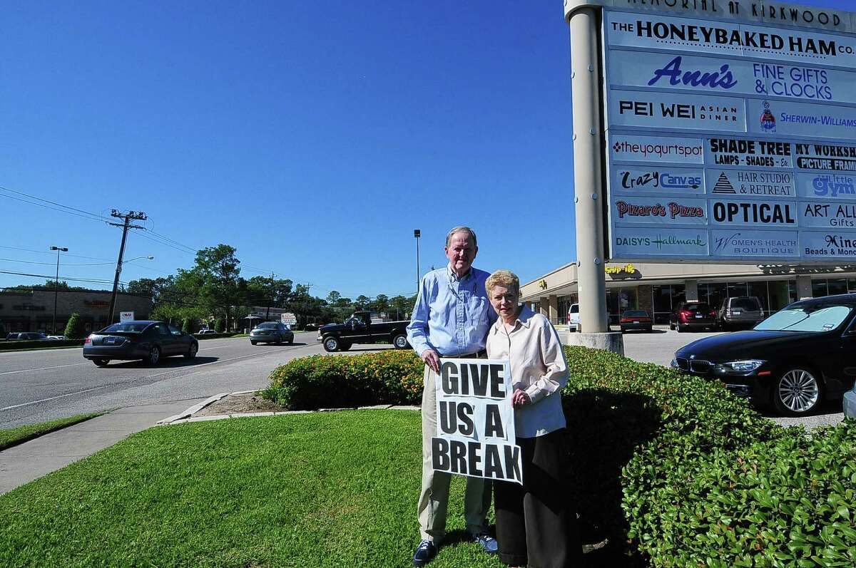 Bill and Ann McClintock, owners of Ann's Fine Gifts and Clocks, express their opinion about the plan for a median near their business on Memorial Drive.