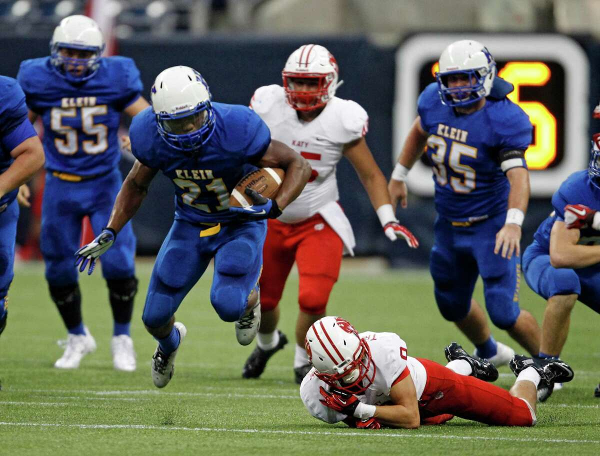 Klein's David Hamm escapes the tackle of Katy's Travis Whillock during the first half of a high school football game, Thursday, August 29, 2013 at Reliant Stadium in Houston, TX. (Photo: Eric Christian Smith/For the Chronicle)