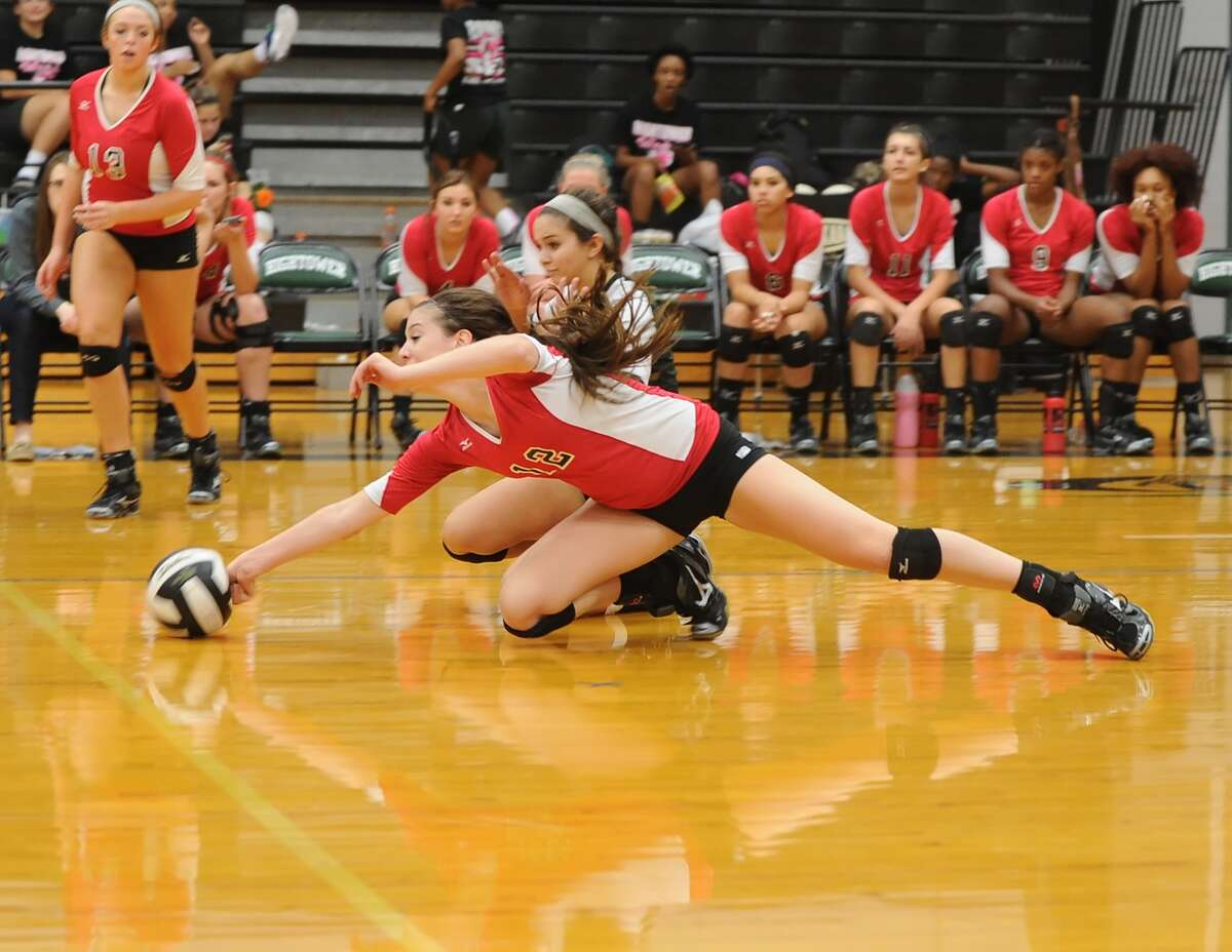 Austin's Paige Swinney just missed this dig against Hightower, but the Bulldogs haven't missed the playoffs, entering the postseason as a favorite to go deep in Region III.