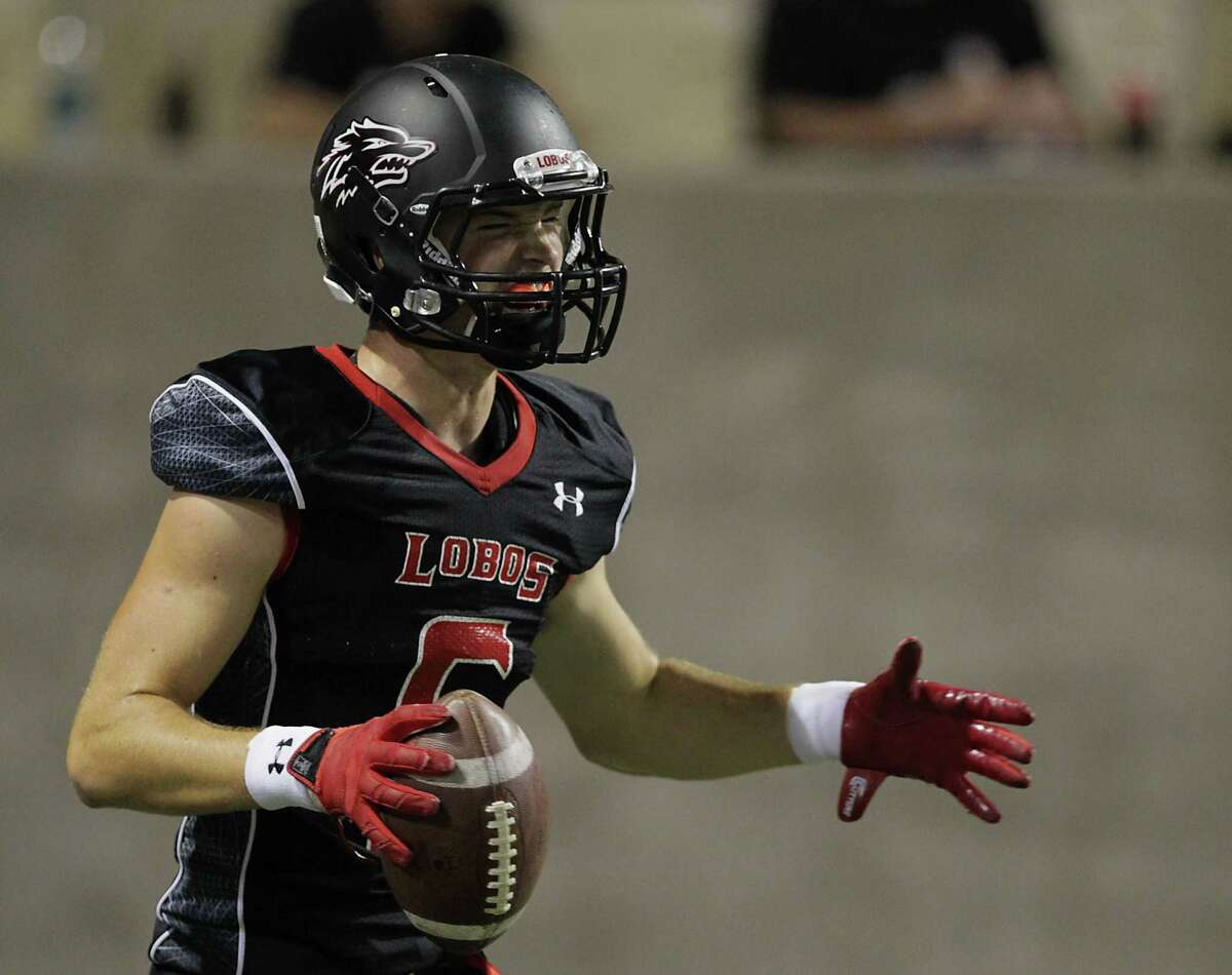 Langham Creek's Bryce Elkin reacts after scoring a touchdown against Cypress Springs during the first quarter of high school football game action at the Berry Center Thursday, Oct. 24, 2013, in Cypress. ( James Nielsen / Houston Chronicle )