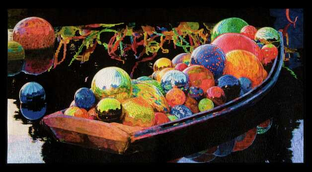 """""""Chihuly's Gondola"""" by Melissa Sobotka is winner of the Handi Quilter Best of Show Award, the $10,000 top prize at the 2013 International Quilt Festival Houston."""