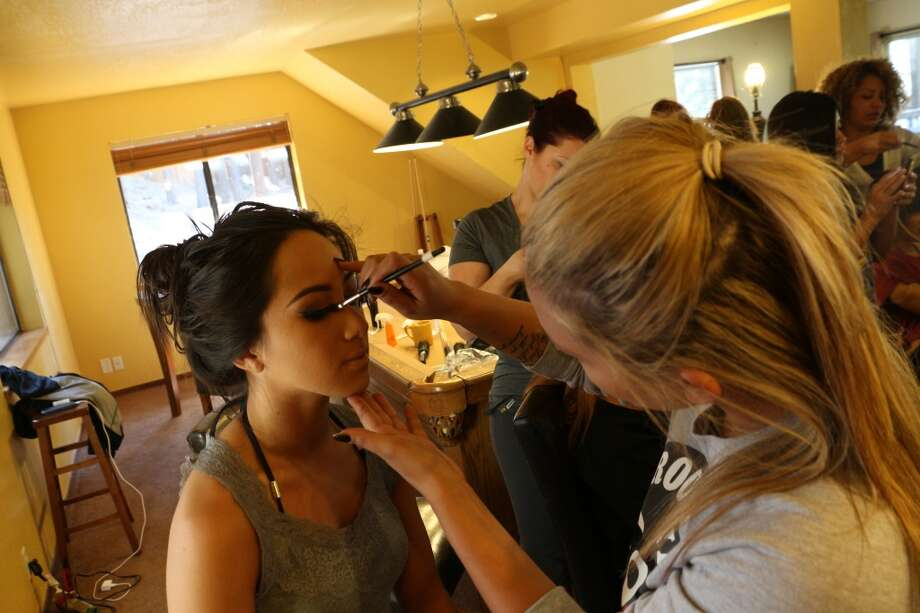 The Warriors Girls get their makeup done before their calendar photoshoot. Photo: Warriors.com, Courtesy