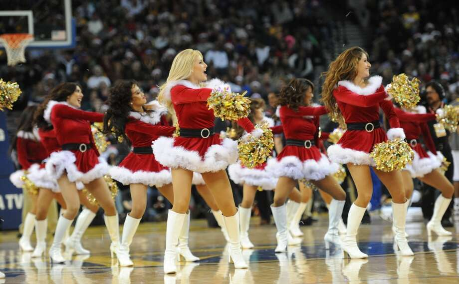 Golden State Warriors Girls are seen during the second half of the game against the LA Clippers at the Oracle Arena on Sunday, December 25, 2011. Photo: Susana Bates, Special To The Chronicle