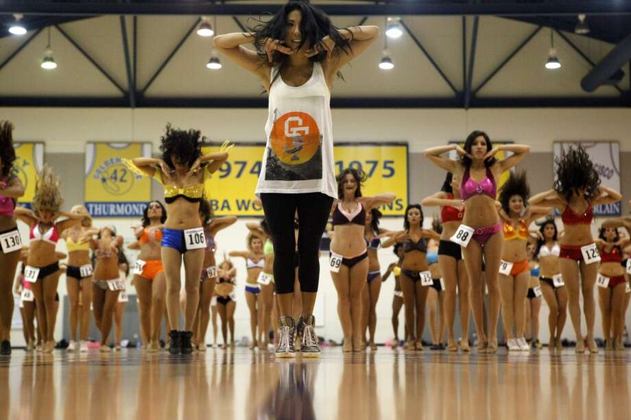 Kristin Egusa, Warrior's Choreographer, leads dancers and performers in routines at the audition to be part of the next group of Warrior Girls, the official dance team of the Golden State Warriors.  The 2013 Warrior Girls Preliminary Auditions were on Saturday, July 20, 2013 at the Warriors Practice Facility in Oakland, CA Photo: Katie Meek, The Chronicle