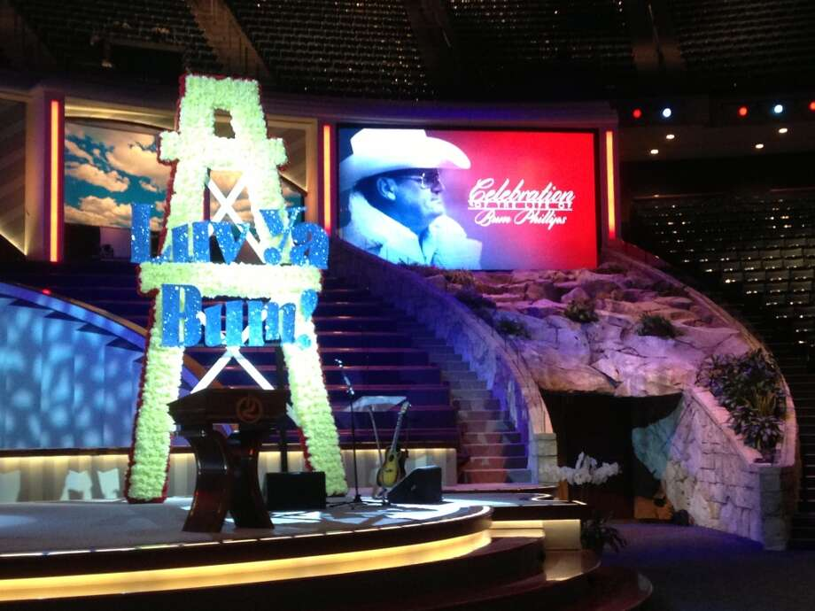The stage for Bum Phillips' memorial being prepared at Lakewood Church. Photo: James Nielsen, Houston Chronicle