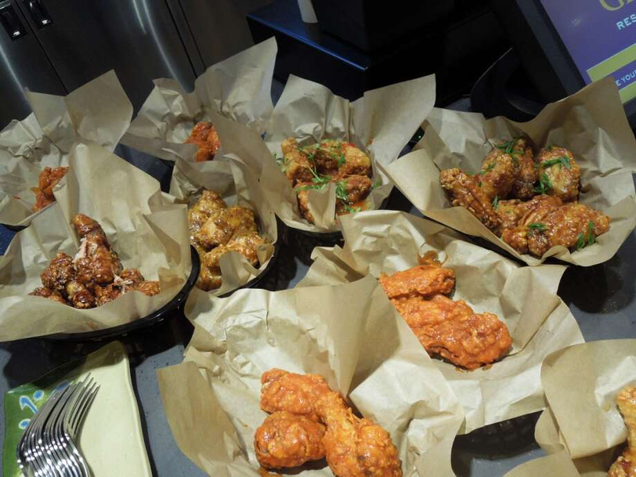 Orders of chicken wings ready to go for a staff preview tasting -- and staff includes former Cyrus teammates Nick Peyton and Drew Glassell, plus a former Cyrus captain.