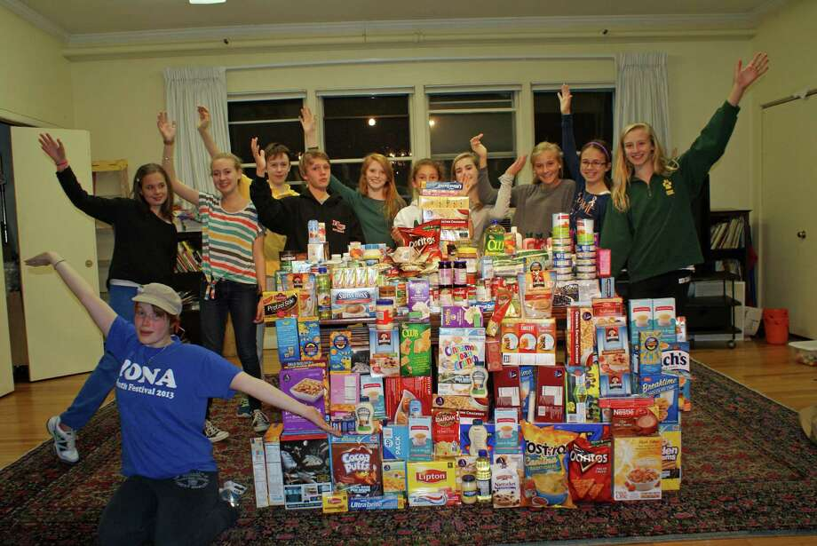 Members of the youth group at First Presbyterian Church display food purchased for the food pantry during their 30-hour famine event. Photo: Contributed Photo / New Canaan News