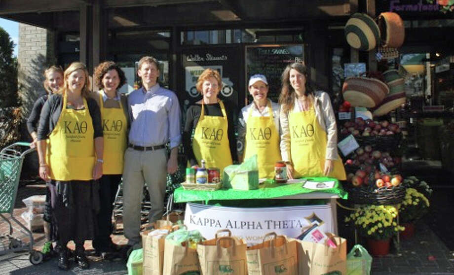 Members of the Fairfield County Theta Alumnae Chapter pause outside Walter Stewart's Market during their Day of Service on Friday, Oct. 19. More than 50 bags of groceries were collected for the New Canaan Food Pantry at St. Mark's. Above, from left, Kristin Selvala, Helen Sparks, Eileen Hill, Alex Stewart, Judy Neville, Marsha Miflin and Caryn Frick. Photo: Contributed Photo / New Canaan News